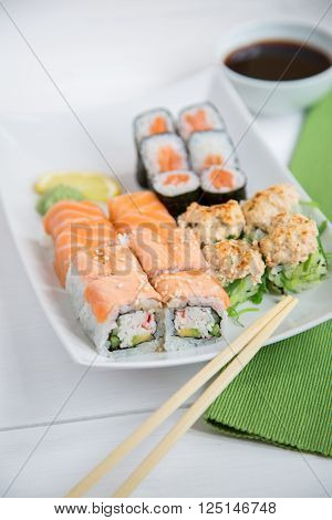 Sushi set with sauce on white background
