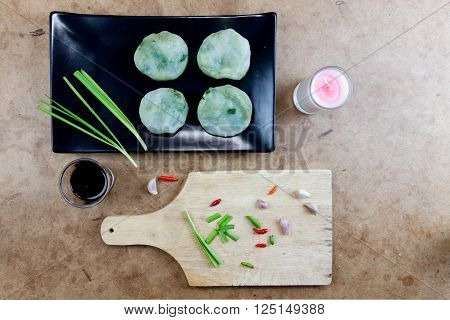 Allium tuberosum. Garlic chives with soy source. Dim sum is chinese cuisine. Dimsum. Flat Lay in Food.