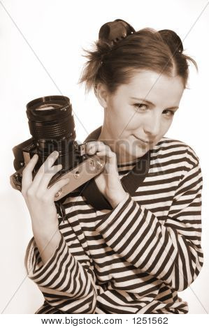 The Girl With A Old Camera In A Hand