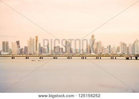 Panama City Panama - August 26 2015: Panama city skyline is seen at sunset on August 26 2015 in Panama Central America. Panoramic view