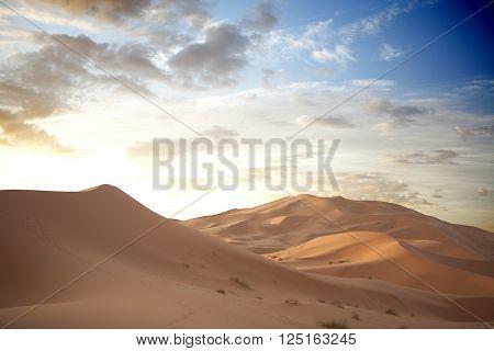 Sunrise over Erg Chebbi dunes area Merzouga Morocco