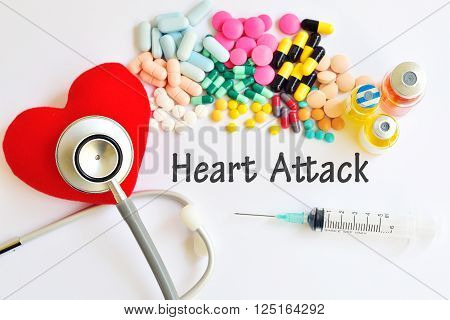 Heart, drugs, syringe and stethoscope, heart disease concept