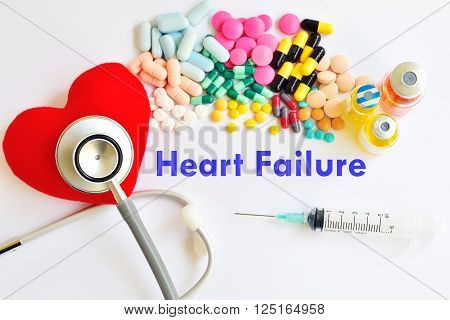 Heart, stethoscope, drugs and syringe, heart disease concept