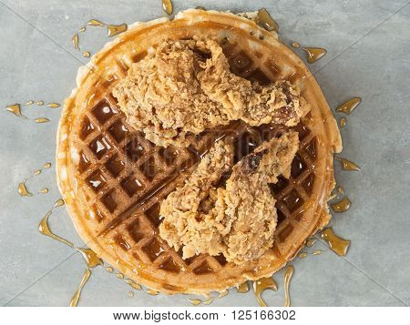 close up of rustic southern american comfort food chicken waffle