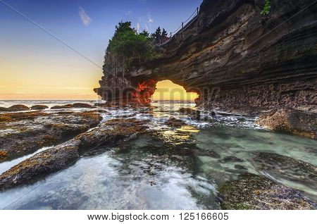 Sunset at Pura Batu Bolong Tanah Lot Bali Indonesia. poster