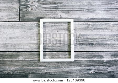 Long see-through frame hanging on antique wooden wall. Mock up