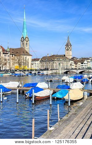 Zurich, Switzerland - 10 April, 2016: Fraumunster and St. Peter Church view across the Limmat river. Zurich is the largest city in Switzerland and the capital of the Swiss canton of Zurich.