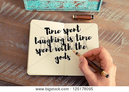 Handwritten quote Time spent laughing is time spent with the gods