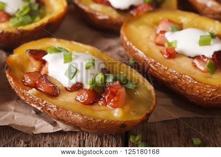 Stuffed Potato Skins With Cheese And Bacon Close-up On The Table. Horizontal