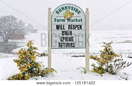 EPHRATA PENNSYLVANIA - APRIL 9 2016: A Lancaster County roadside market which opened on the first day of Spring closed due to an April snowstorm.