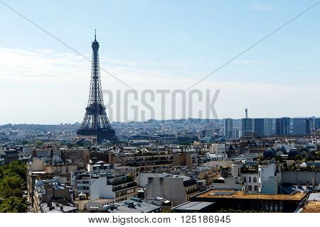 Color DSLR stock image of Eiffel Tower, Paris, France with the capital cityscape in the foreground and background. Horizontal with copy space for text