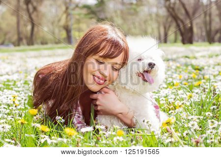 Happy Woman Enjoying Nature With Her Dog