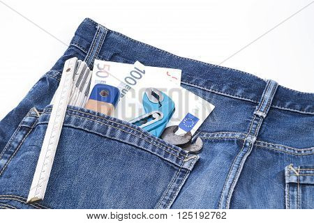 Image shows serveral tools with money in a jeans pocket
