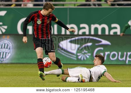 BUDAPEST, HUNGARY - APRIL 10, 2016: Dominik Nagy of Ferencvaros (r) slide tackles Patrik Hidi of Honved during Ferencvaros - Budapest Honved OTP Bank League football match at Groupama Arena.