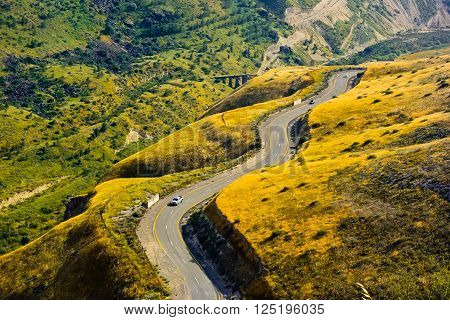 Sharp turns on a mountain road. The twisting road in the mountains