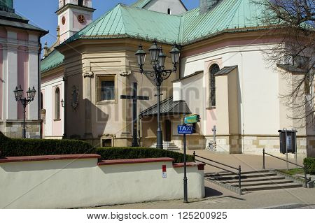 Wieliczka, Poland - April 04, 2016: Zamkowa street, St. Clement. Church of the fourteenth century, was destroyed by an earthquake in 1782. On its foundations it was built in the early nineteenth century, the present baroque church.