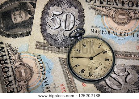 Old hungarian forint money fifty value with old pocket watch