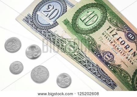 Old hungarian money ten and twenty forint with change isolated on white