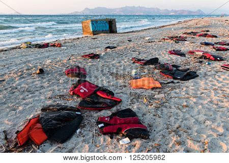 KOS ISLAND, GREECE - OCTOBER 6, 2015: Abandoned life savers of refugees on October 6, 2015 on a beach of Kos island, Greece. Thousands of Syrian refugees passed from Turkey to Greek islands since the summer of 2015.