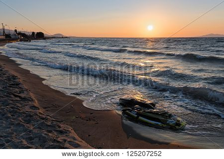 KOS ISLAND, GREECE - OCTOBER 14, 2015: Damaged plastic boat of refugees on October 14, 2015 on a beach of Kos island, Greece. Thousands of Syrian refugees have passed from Turkey to Greek islands since the summer of 2015.