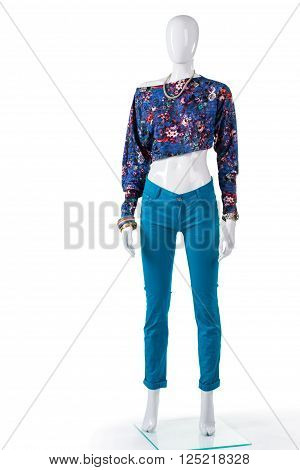 Floral crop top and pants. Mannequin wearing floral crop top. Lady's folded pants with top. Trendy summer top from catalog.