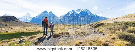 panorama view of family enjoying active vacation in patagonia and hiking in torres del paine national park chile