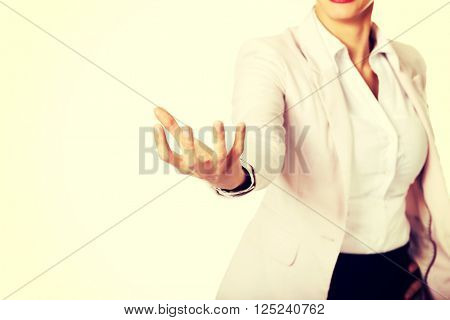 Business woman holding something on hand