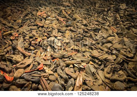 Pile of shoes from the people who were killed by nazis in Auschwitz poster