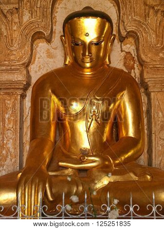Close up of statue of Bhudda in earth-touching mudra. Frontal view. Photo taken in Ananda Temple Bagan Myanmar. (All temples in Myanmar are public space and free to visit.)