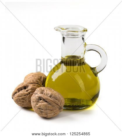 Walnut oil and nuts isolated on white background