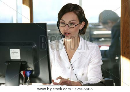 Businesswoman with headset in the office
