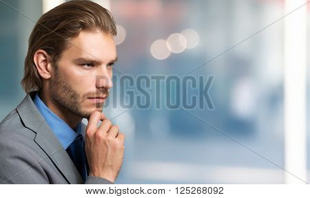 Businessman looking at his side
