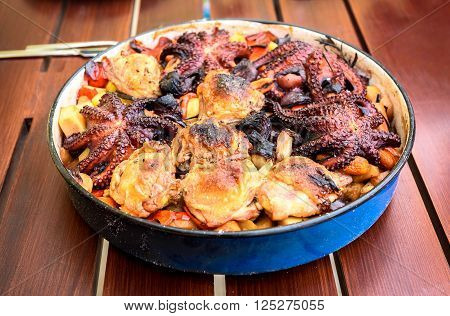 Preparing And Cooking Of Octopus And Chicken In Traditional Balkan Greek Mediterranean Meal Peka
