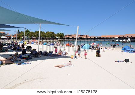 HILLARYS,WA,AUSTRALIA-JANUARY 22,2016: Beach recreation with families and swimming cove at Hillarys Boat Harbour, in Hillarys, Western Australia.