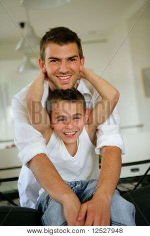 Portrait of smiling man and little boy