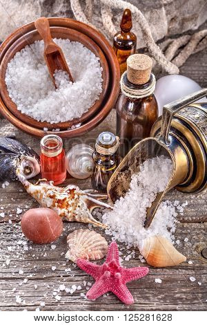 Essential oils and bath salt with a sea shells