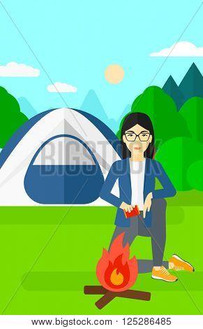Woman kindling fire.