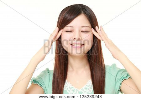 young Japanese woman doing self head massage