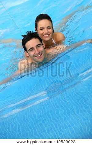 Happy couple swimming