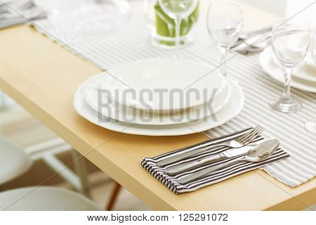 Table served with white dishes and silver flatware
