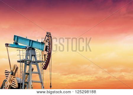Oil pump at sunset. Oil field at sunset.