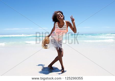 Cheerful Attractive Young African Woman Enjoying Walk On Beach