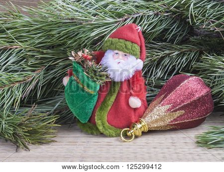Grandparent Frost with toy for fir tree on background of the green branches with needle
