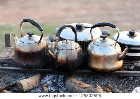 Tea pots on a char coal fire at a picnic area near Dohuk town in Kurdistan Region, Iraq.