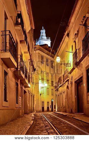 Alfama quarter at night in Lisbon Portugal