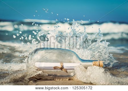 Message in the bottle coming with wave from ocean. Concept of travel, romantic secret, marine