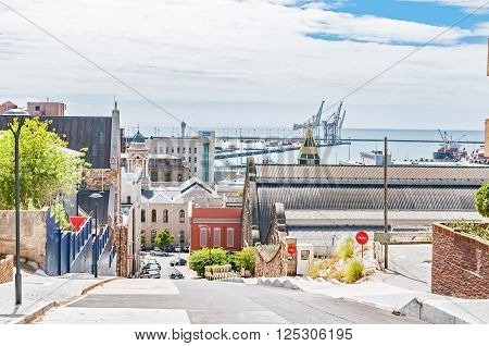 PORT ELIZABETH SOUTH AFRICA - FEBRUARY 27 2016: A street view of Port Elizabeth which includes the original Feather Market building and the harbor