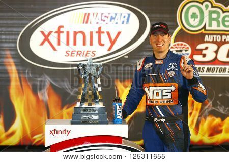 Ft. Worth, TX - Apr 08, 2016: Kyle Busch (18) celebrates after winning the O'Reilly Auto Parts 300 at the Texas Motor Speedway in Ft. Worth, TX.