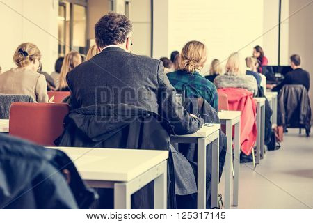 Audience at business conference. People listening to lecture.