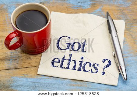 Got ethics? Are you ethical question. Handwriting on a napkin with cup of coffee.